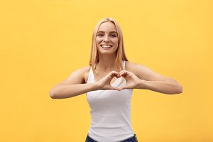Beautiful Woman Making Heart Shape
