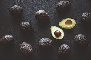 Hass avocados on the dark background