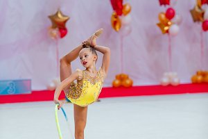 Beautiful little active gymnast girl
