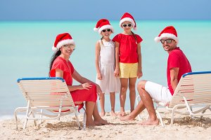 Happy family with two kids in Santa
