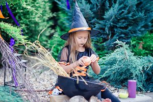 Happy girl in halloween costume with