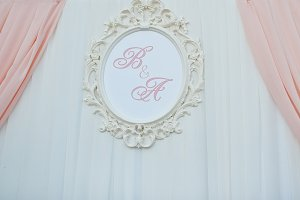 Wedding arch with frame of initials