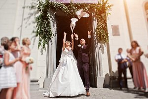 Wedding couple with releasing doves