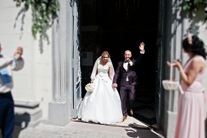 Wedding couple exit from church afte
