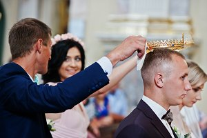 Best man and bridesmaid hold a weddi