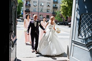 Wedding couple at entrance of church