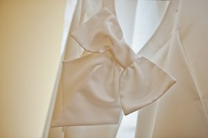Bow of back of white wedding dress a