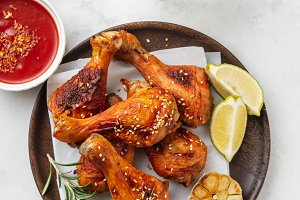 Chicken legs with sauce, rosemary