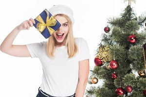 excited woman in santa claus hat wit