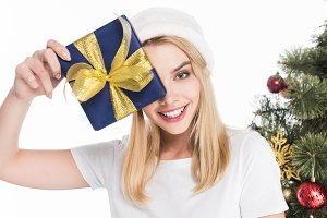 smiling woman in santa claus hat hol