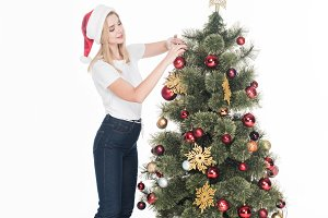 young woman in santa claus hat decor