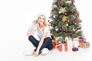 cheerful young woman in santa claus