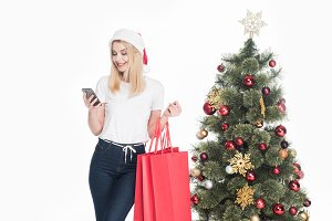 young woman in santa claus hat with