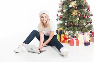 smiling woman in santa claus hat wit