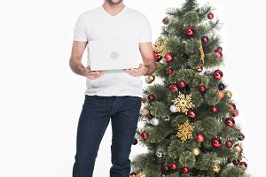 man in santa claus hat with laptop i