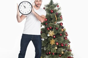 man in santa claus hat with clock st