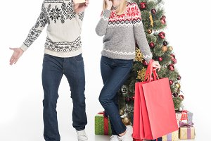 couple in sweaters and santa claus h