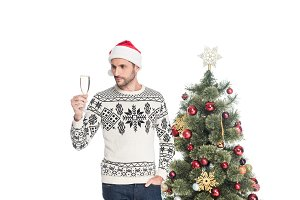man in sweater and santa claus hat w