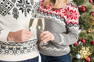 cropped shot of couple in sweaters c