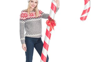 young woman in sweater and santa cla