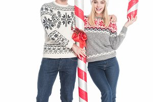 smiling couple in santa claus hats a