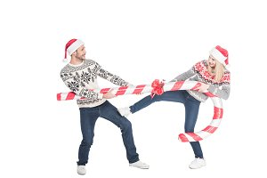 young couple in santa claus hats and