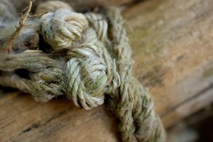 Old dirty rope on the wood