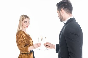 fashionable couple clinking glasses