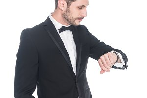 young man in fashionable suit checki