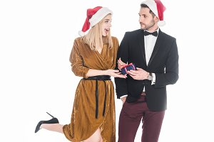 stylish young couple in santa claus