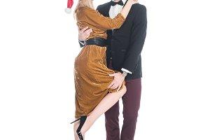 fashionable couple in santa claus ha
