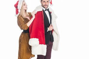 young woman putting santa claus cost
