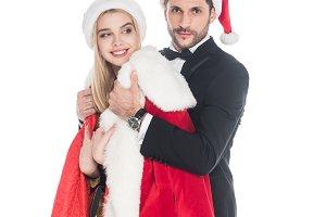 young man putting santa claus costum