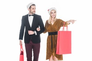 attractive couple in santa claus hat