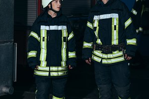 firefighters in protective uniform a
