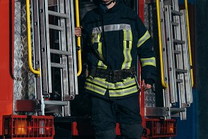 fireman in protective uniform and he