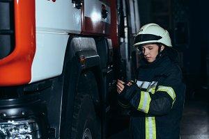 female firefighter in helmet checkin