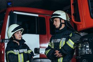 firefighters in fireproof uniform an