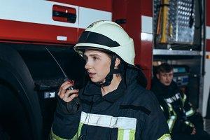 female firefighter talking on portab