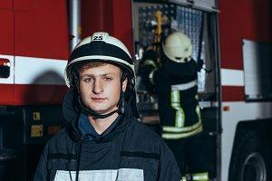 male firefighter in helmet looking a
