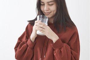 Cute girl drinks milk. portrait