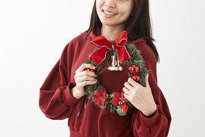 Girl holding Christmas wreath