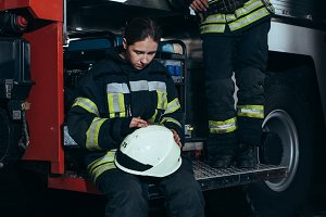 firefighters in protective uniform n
