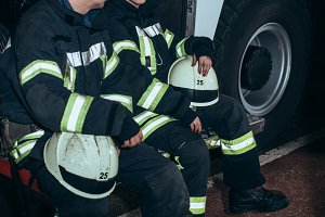 firefighters in protective uniform h