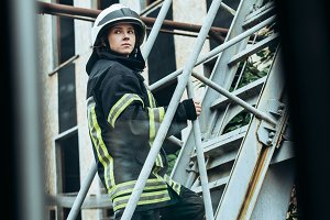 female firefighter in protective uni