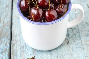 Cherries in the beautiful cup on woo