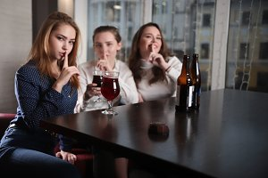 Three young women sitting in a cafe