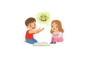 Cute little boy and girl reading a