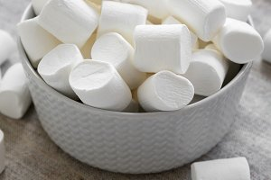 Sweet white marshmallows in a bowl
