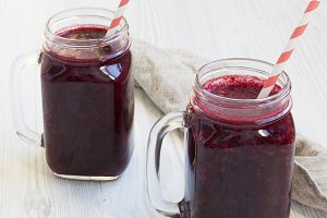 Glass jars with berry smoothie